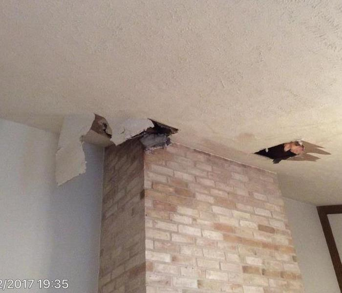 Storm water intrusion thru chimney wet ceiling