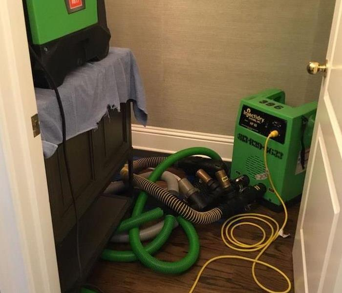 InjectiDry cleaning on wood floors in a bathroom